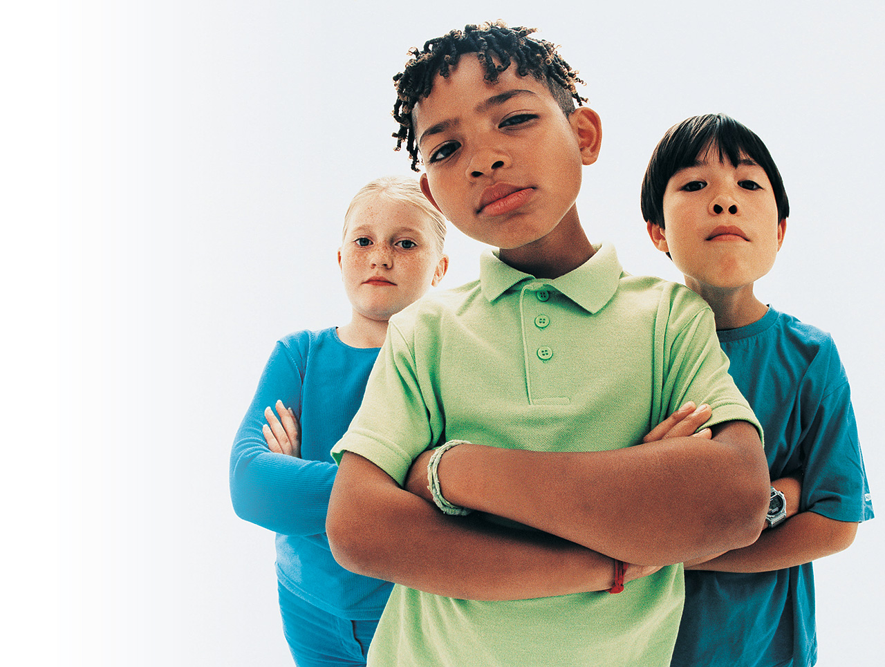 three children with arms folded